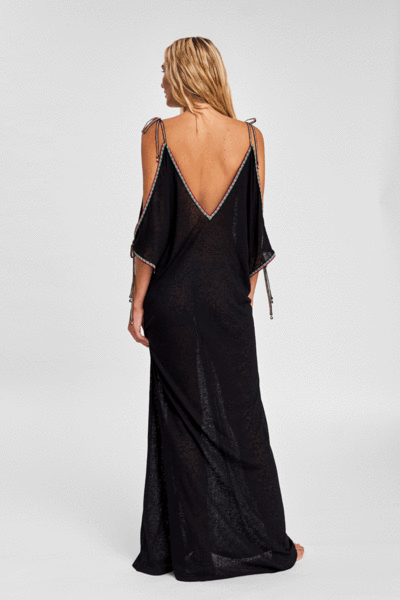 the back of a cold shoulder beach dress