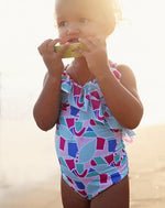 adorable girl wearing frill front swimsuit