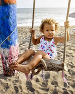 little girl swinging in swimming costume
