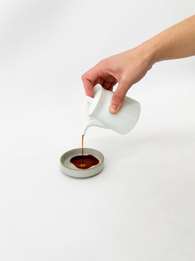 Pouring soy sauce out of the G-Mark Soy Sauce Pot by Masahiro Mori
