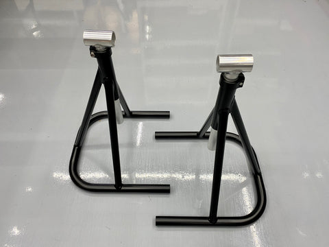 Motorcycle footpeg paddocking stands