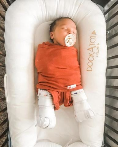 How to Swaddle a Newborn Baby in a Pavlik Harness or Rhino