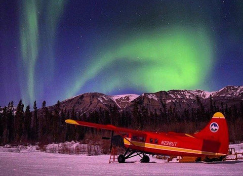 Flying in Alaska under the northern lights