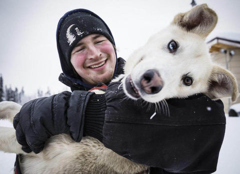 Riley Dyche with his husky dog