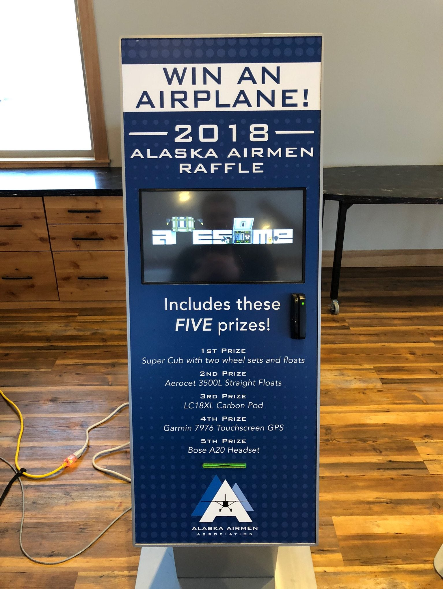 Alaska Community Partners works with the Alaska Airmen's Association in Anchorage, Alaska to sell raffle tickets via kiosk machine