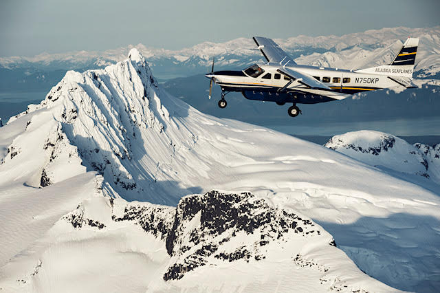 Alaska Seaplanes flying over a glacier near Juneau, Alaska
