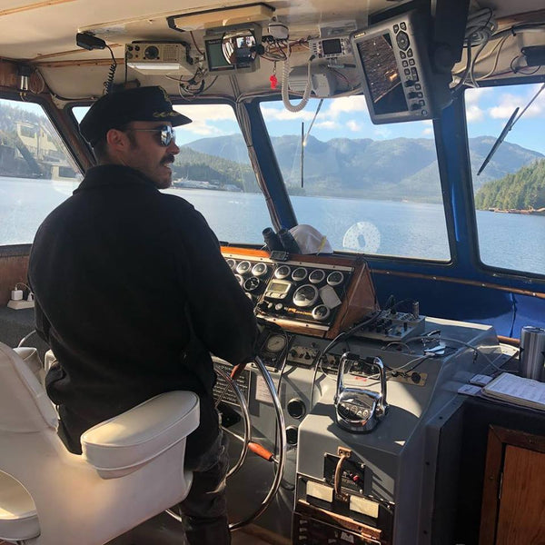 Jeff Karlson at the helm of his boat, the Endeavor, in Ketchikan