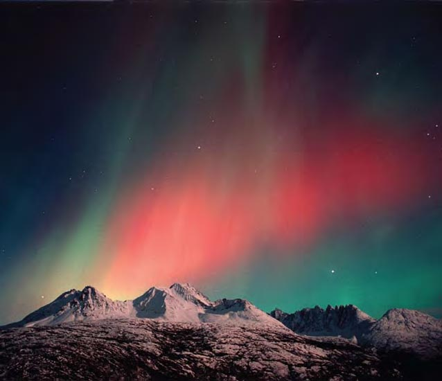 Northern lights behind the Sawtooth Mountains near Skagway, Alaska