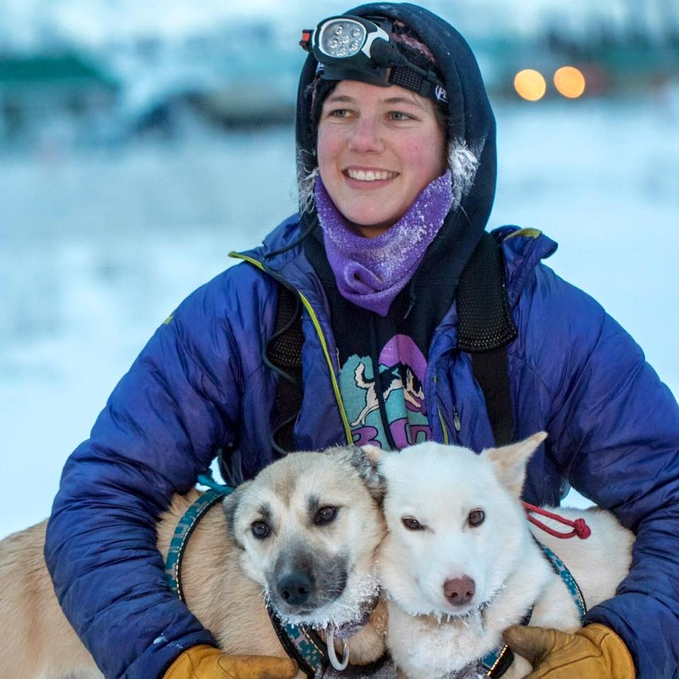 Ryne Olson with her huskies near Two Rivers, Alaska