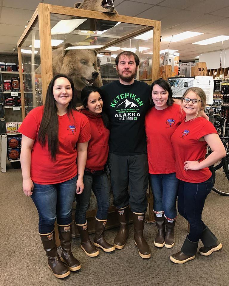 Employees of Tongass Trading Co. wearing Ketchikan's XTRATUF® boot also called the Ketchikan sneaker for how much it rains in Ketchikan, Alaska