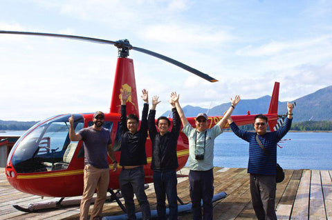 A group of cruise travelers enjoying a helicopter ride in Ketchikan, Alaska