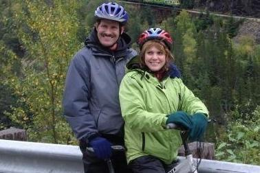 A couple enjoying a bike ride in Skagway, Alaska