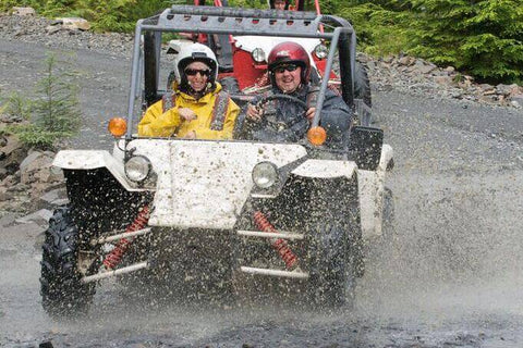 Adventure karts driving through mud in Ketchikan, Alaska