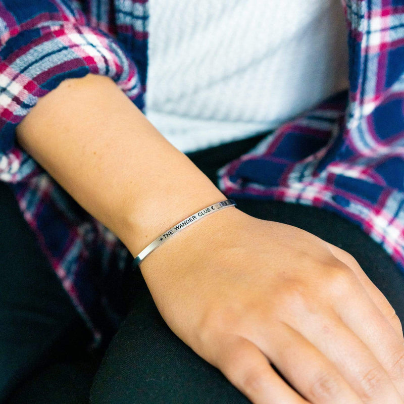 Silver - The Wander Club - Mantra Cuff on girl's wrist