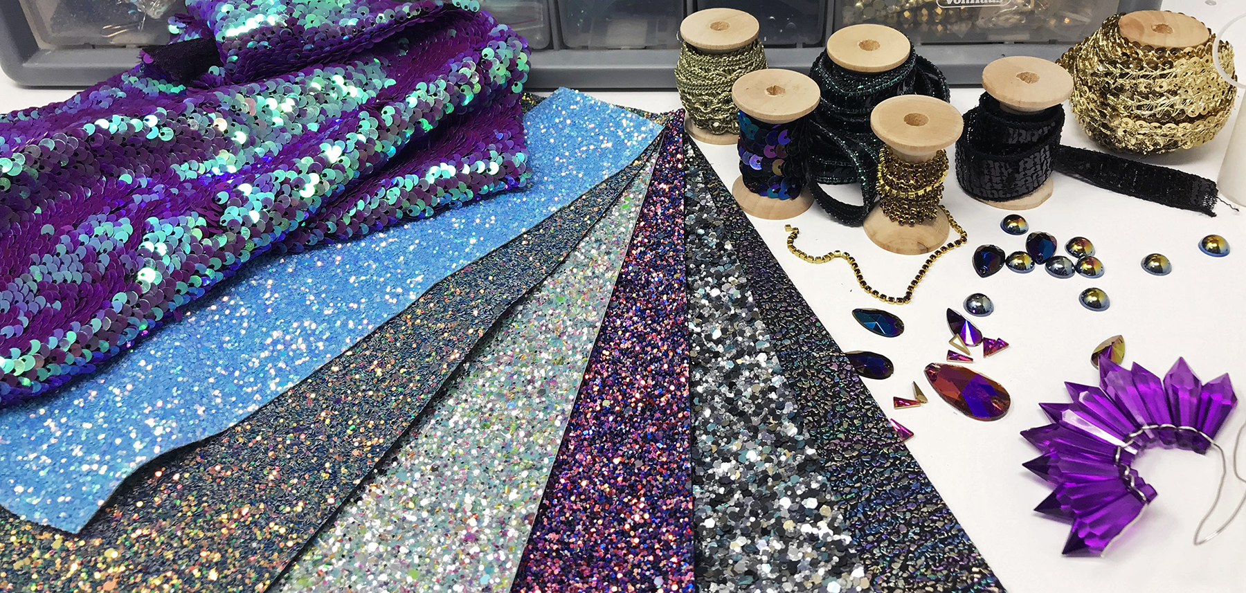 Glitter fabric, sequins, gemstones and crystals.