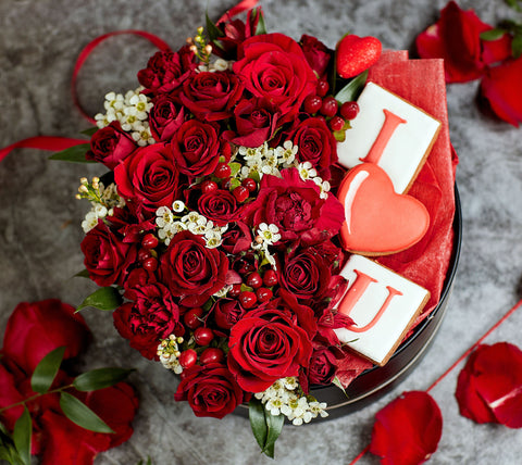 Red Roses in a box; flowers in a box with cookies