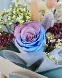 Preserved purple and blue rose bouquet