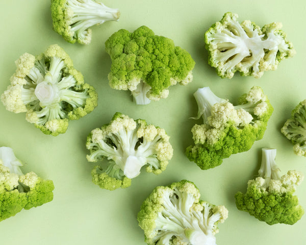 Broccoli on green background