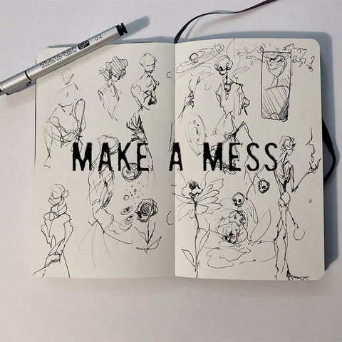 sketchbook open with mesy pen drawing inside of figures, Make a mess written across the page