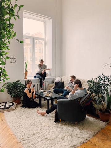 four friends relaxing in living room