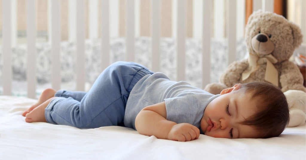 child development stages your baby will roll over while they are asleep