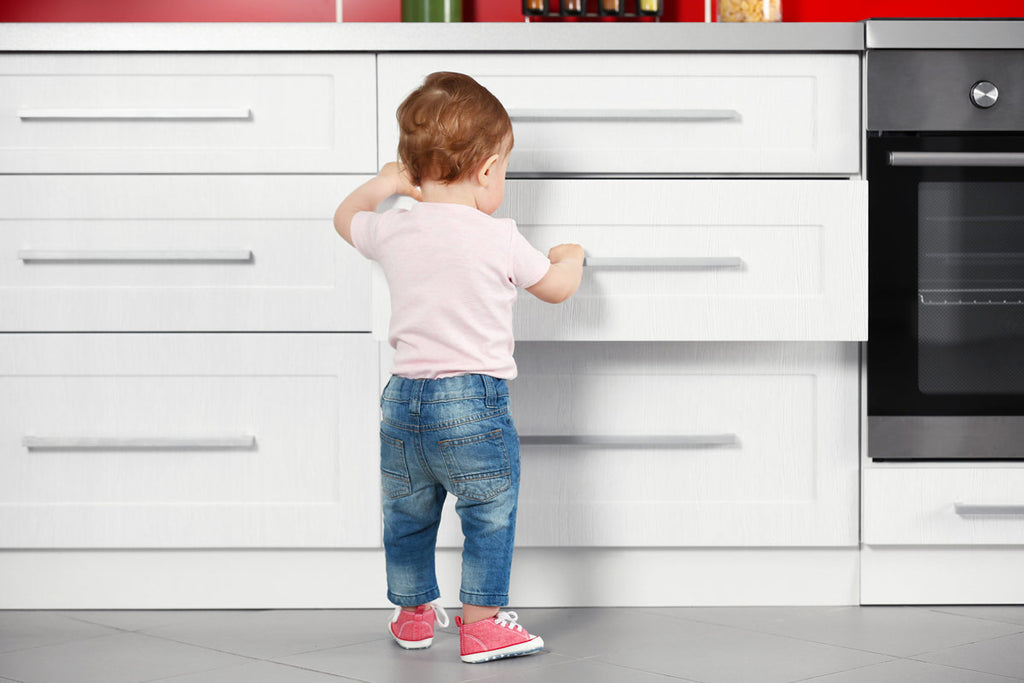 Toddler opening kitchen cupboards without baby proof locks