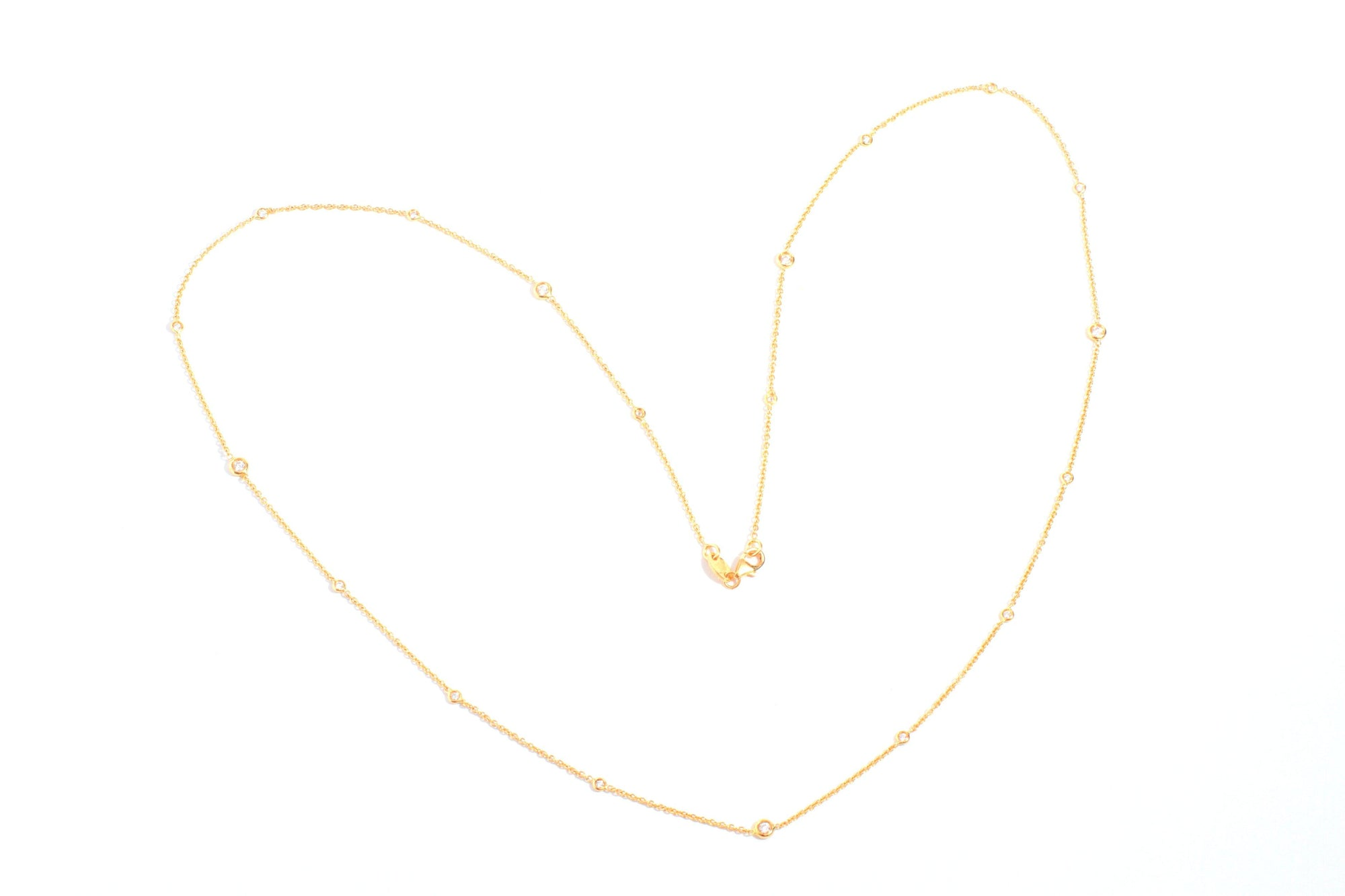 Yellow gold necklace set with white diamonds