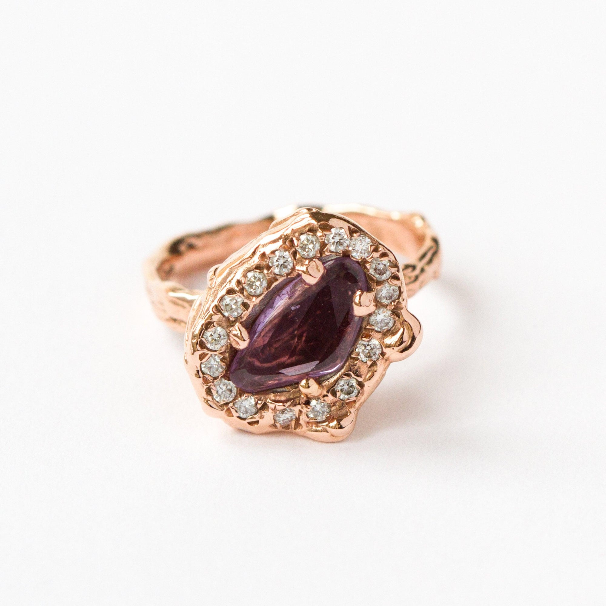 Rose gold ring handmade set with white diamonds and rose/purple sapphire rose cut