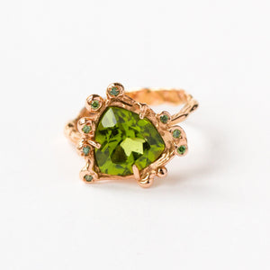 18ct rose gold ring set with green diamonds and green Tsavorite trillion cut