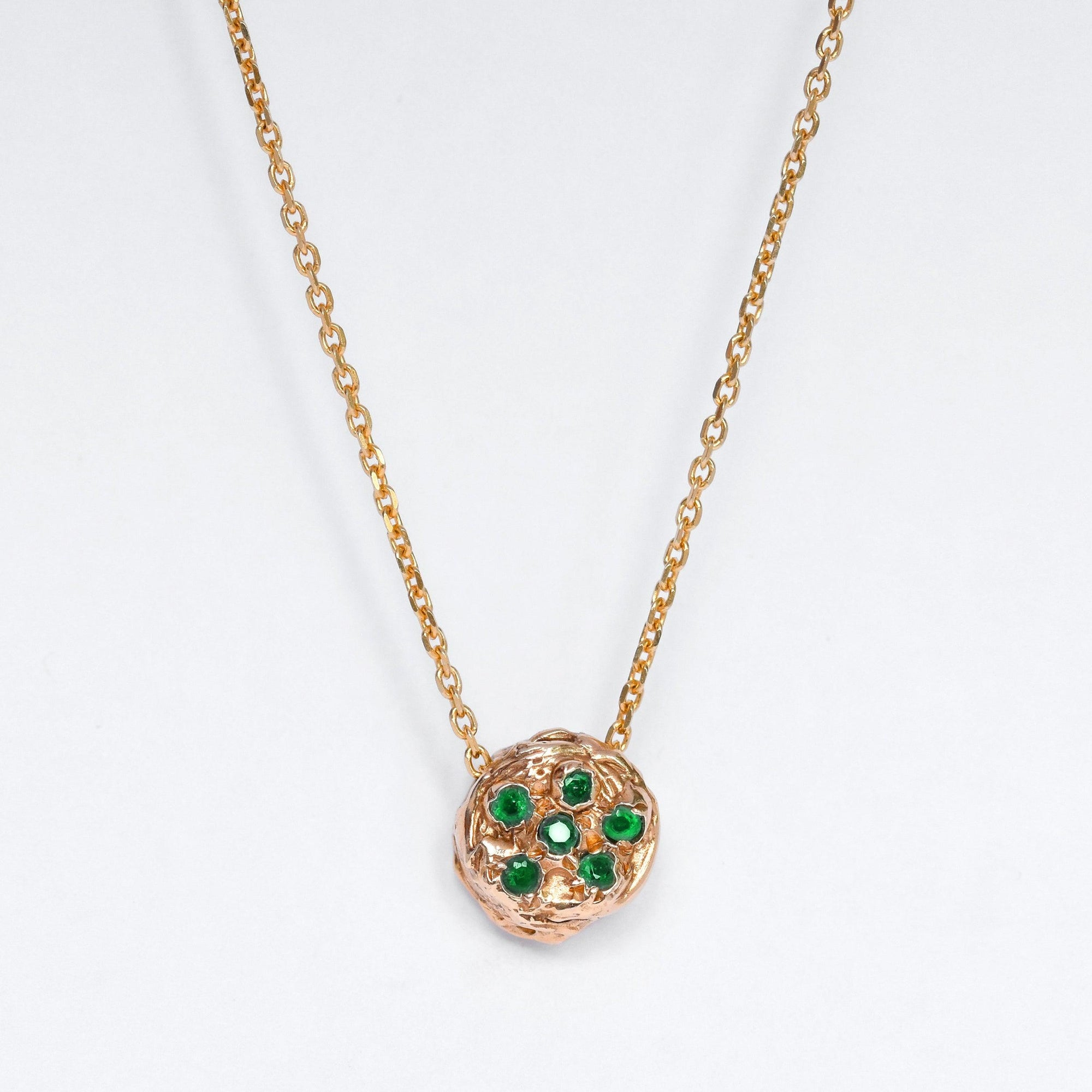 Gold Necklace set with emeralds