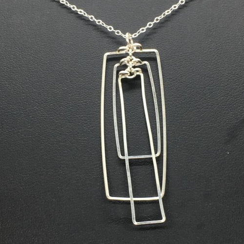 The triple stacked rectangle necklace, handmade from wire, then attached to a delicate sterling silver chain