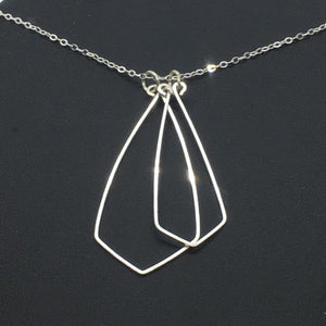 The double stacked geo necklace, handmade from wire, then attached to a delicate sterling silver chain.