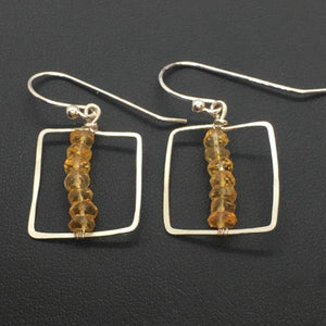 3mm faceted citrines centered on a sterling silver hammered square frame.