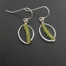 3mm faceted peridot stacks centered on a sterling silver hammered leaf frame.