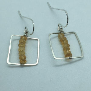 sterling silver frame with faceted citrine stones