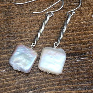 White square freshwater pearls dangle from sterling silver swirl. Sterling silver French hooks.