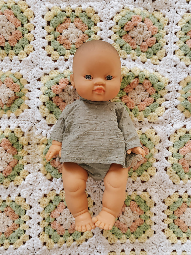 Baby doll, Asian male with blue eyes, in sage pajamas
