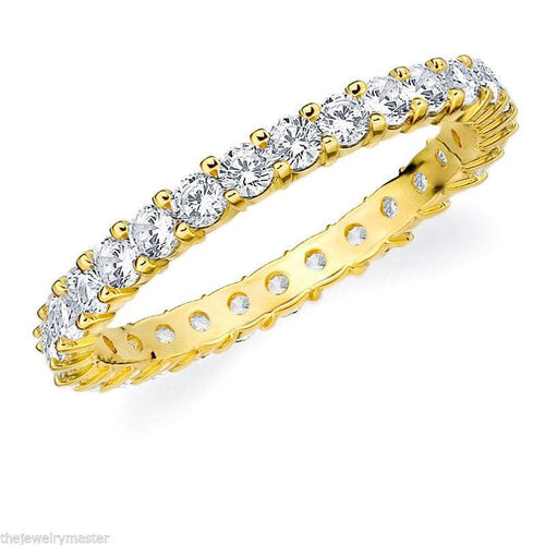Yellow Gold Eternity Band With Round Stones In 4.00 Carat Total Weight.