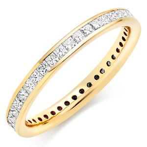 Yellow Gold Eternity Band With Princess Channel Set Stones In 1 Carat Total Weight.
