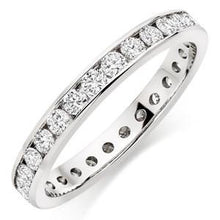 Eternity Band With Round Channel Set Stones In 1 Carat Total Weight.
