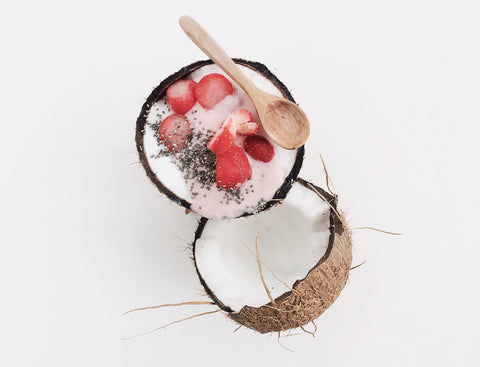 Coconut shell with berries inside