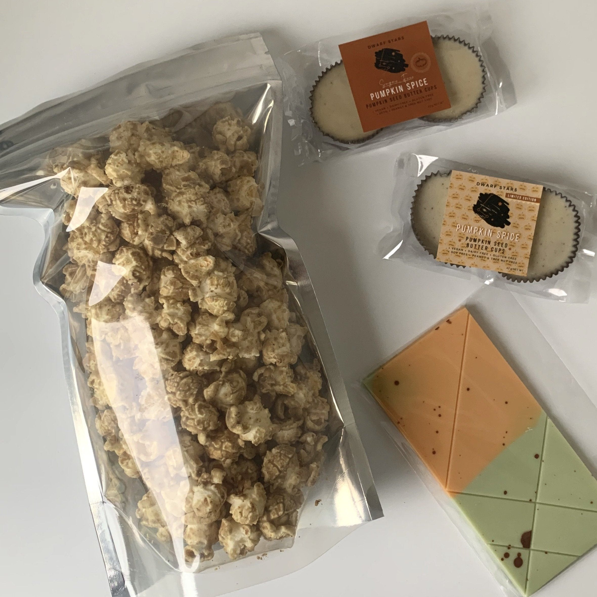 Pumpkin Spice Vegan White Chocolate Popcorn, cups and vegan chocolate bar