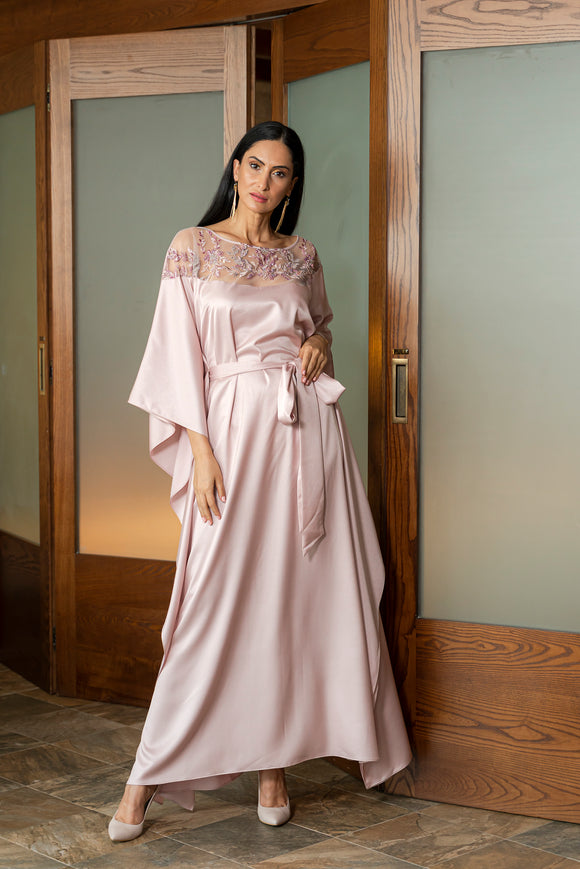 Out to update your modest-wear wardrobe with Gunay Hafiz's hand beaded embellished kaftan which will offer you chic appeal for majlis nights. Cut from weightless crepe silk blended fabric, this kaftan style has a floor skimming silhouette and a sophisticated round neckline.
