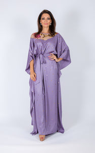 Sequinned kaftan embellished with silk fabric on the neckline. Comes with removable belt made from satin fabric