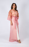 Turn heads at your next event in magnificent full-length cape. This beautiful piece comes with sequins embellishments.