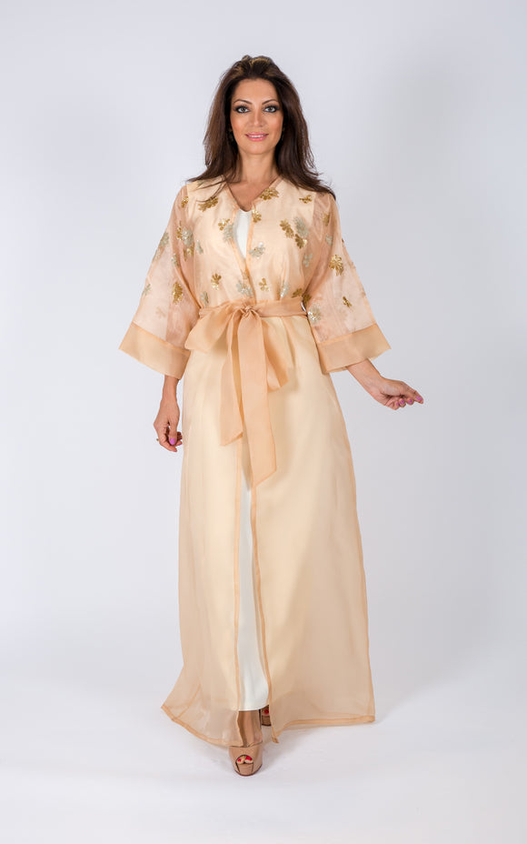Tuns heads at your next event in magnificent full-length cape. This beautiful piece comes with embellishments.