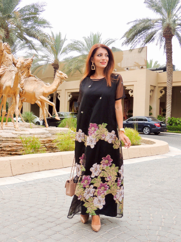 Dress Kaftan which shows the confidence and femininity with an artistic touch. Its made from silk organza combined with beautiful brocade material. Complement the maxi length.