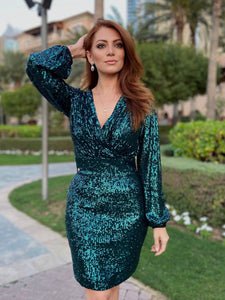 Shimmering Dress is a girl's dream dress. Drenched in green sequins. This high-voltage dress features a modest, yet elegant silhouette.