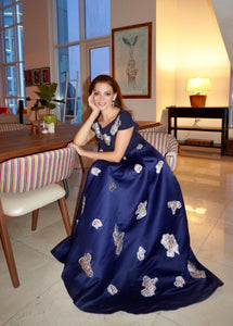 Royal Blue gown combines lady-like elegance, with metallic-gold brocade embellishments. A round neckline compliments the magnified short sleeves. A floor-skimming length makes for an outfit ready to take on the evening.