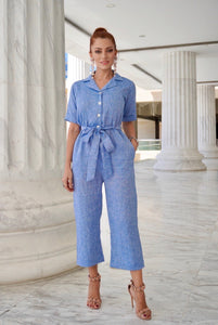 Playful but ready to take care of business Natural Linen Jumpsuit is work-appropriate and easy to dress up or down. Features shell buttons, side pockets and removable belt.
